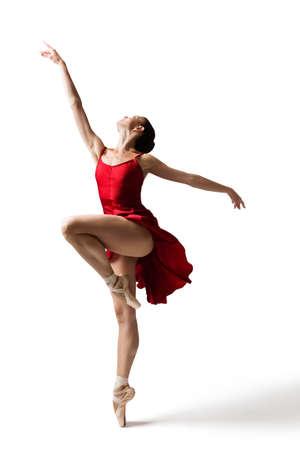 Ballerina Jumping, Modern Ballet Dancer in Pointe Shoes, Fluttering Dress, Isolated White Background Banco de Imagens