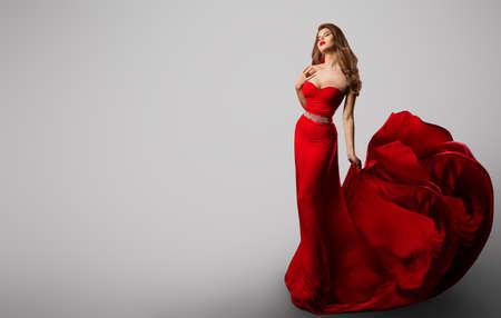 Beautiful Fashion Model in Red Dress, Woman Beauty Portrait, Elegant Lady in Long Sexy Gown Banco de Imagens