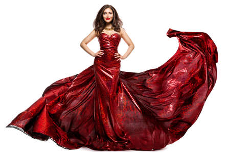 Beautiful Woman in Red Evening Dress, Elegant Fashion Model in Fluttering Sparkling Gown Isolated White Reklamní fotografie