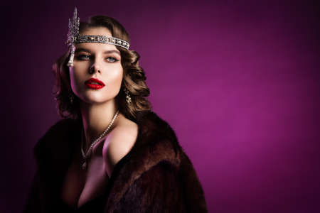 Retro Fashion Model in Fur Coat, Diadem, Woman Beauty Vintage Hairstyle Makeup, Old Fashioned Portrait over Purple Background