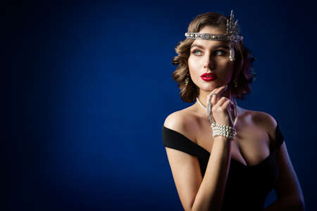 Retro Beauty Flapper Portrait, Woman Old Fashion Gatsby Hairstyle and Make Up, Blue Studio Background