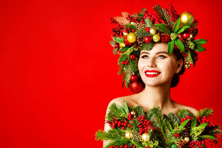 Xmas Happy Smiling Woman Makeup Portrait, Christmas Tree Wreath Hairstyle.  Face Model Make up with Red Lips, New Year Beauty Girl Looking up on Studio Background