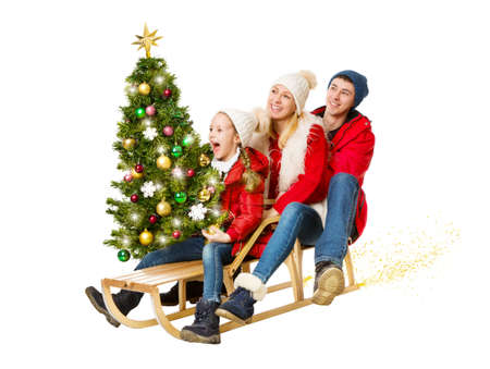 Happy Family carrying Decorate Christmas tree Gift. Parents and Child ridding Sled in Outdoor Clothing. Christmas Present Sale and Delivery Concept. Cut out White Studio Background Banco de Imagens