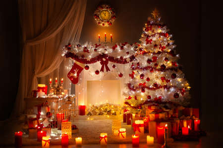 Christmas Room Interior Design. Xmas Tree Decorated By Lights. Fireplace and Clock. Presents Gifts Toys, Candles and Garland Shining at Night