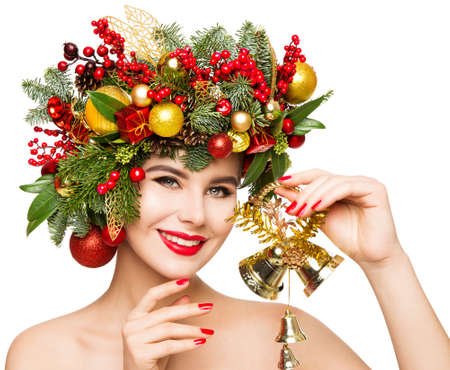 Christmas Woman Gift Bells. Beautiful Girl Fashion Make up and Xmas Party Wreath Hairstyle. Isolated White