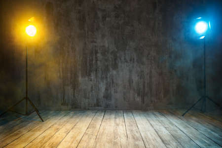 Grunge Mist Stage Background. Beams of Lights, Spotlight in Smoke over cracked Wall and wooden Floor. Nobody Foto de archivo