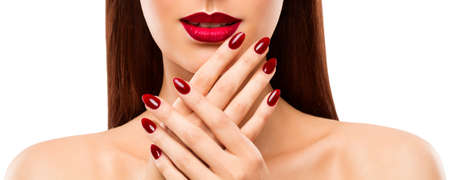 Nail Lip Beauty Model. Woman showing Hands with red Polish. Skin Care. Makeup Close up White Imagens