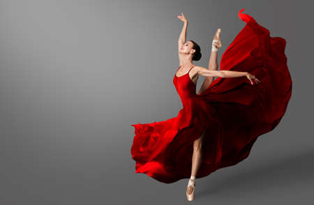 Ballerina Dance. Ballet Dancer in Red Dress jumping Spit. Woman in Ballerina Shoes dancing in Evening Silk Gown flying on Wind
