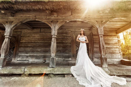 Bride White Dress. Romantic Woman Wedding White long Gown. Fantasy Old fashioned bridal Clothing. Antique Style Wooden House