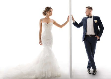 Wedding Couple touching Hands through Wall. Barrier between Bride Groom. Marriage Concept of Loving Pair Man Woman Standard-Bild