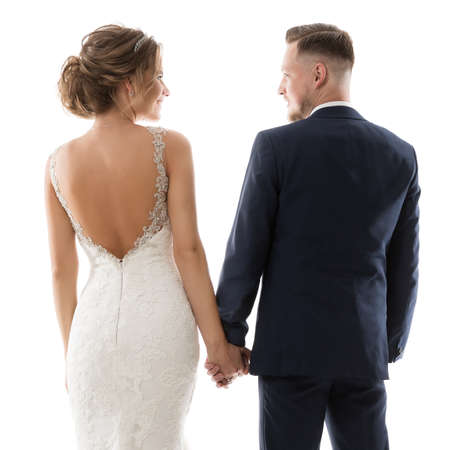 Wedding Couple Rear View, Romantic Bride and Groom Back Side, Elegant Studio Portrait in White Dress and Black Suit. Isolated
