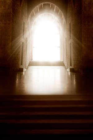 Church Interior. Window Light in Dark Inside Room. Shining Door in front Empty Steps. Mystery Background Foto de archivo