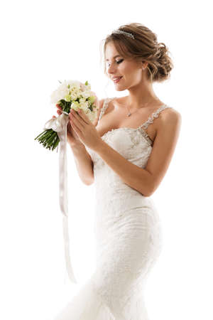 Bride Flower Bouquet. Beauty in Wedding Dress holding White Roses. Isolated White