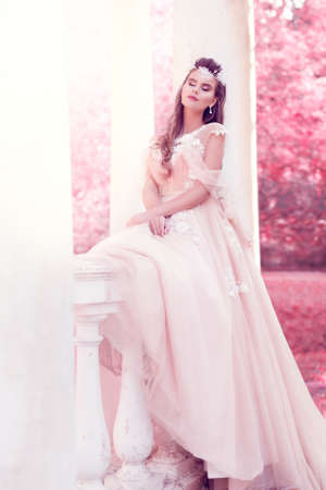 Bride Back Wedding Dress. Woman take off White Gown. Rear View lady over Black Background. Bridal Fashion