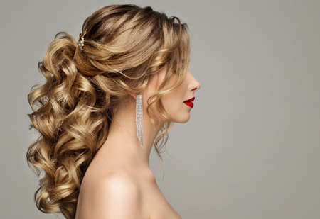 Beauty Woman Hair Style. Bride Wedding Hairstyle Side View. Fashion Model Portrait with Elegant Curly Hairdo over Gray Background