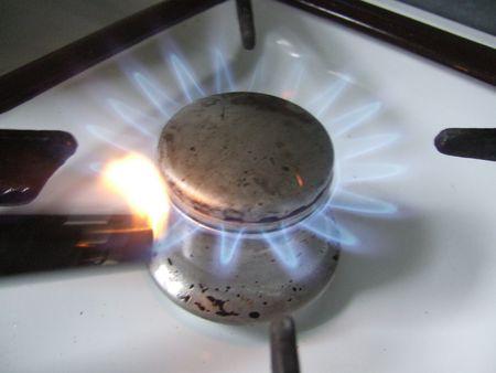 gas lighter: gaslight of a stove