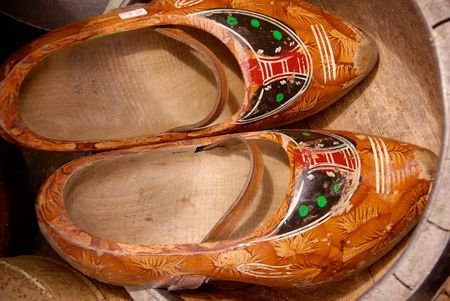Ancient wooden shoes photo