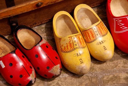 Painted old wooden shoes photo