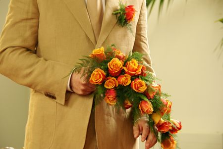 The groom with the wedding bouquet of roses Stock Photo - 3336246