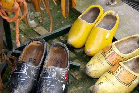 Old painted wooden shoes photo
