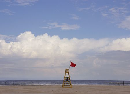 The chair of a beach watch at the beach with a cloudy sky Stock Photo - 3480208