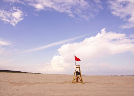 The spacious beach of Schiermonnikoog, the Netherlands with a chair of the beach watch Stock Photo - 3482776