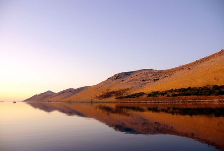 The island Kornat in Croatia in the early morning sun photo