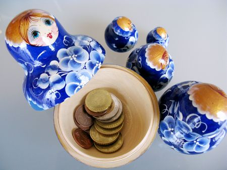 treasurer: Sharing a budget in money boxes Stock Photo