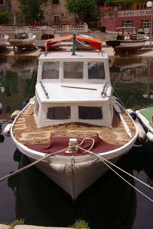 fishingboats: A small fishing vessel with carpets