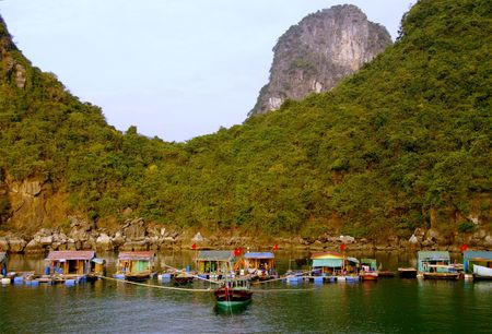 Fishing vessel at the floating village in Halong bay in Vietnam photo