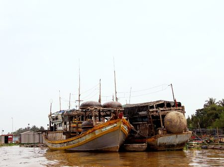 Fishing ships with traditional fishing baskets in the Mekong delta