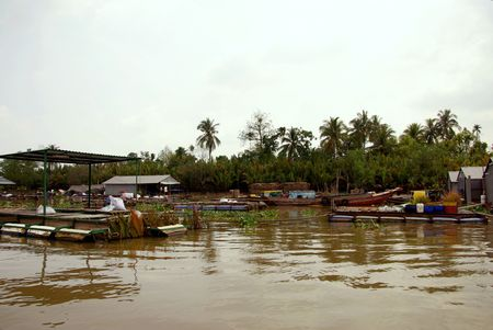 Floating village in the mekong delta in Vietnam Stock Photo - 4288234
