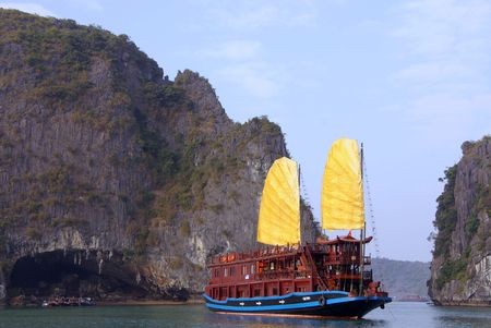 cruis: A cruis ship with yellow sails in Halong bay in Vietnam