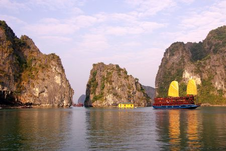 A cruise ship with Jonk sails in Halong bay in Vietnam