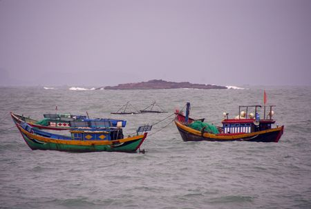 fishingboats: Fishing boats in bad weather at the coast of Vietnam