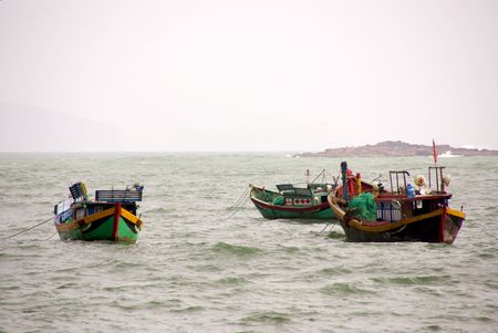 Fishing boats in bad weather at the coast of Vietnam Stock Photo - 4409364