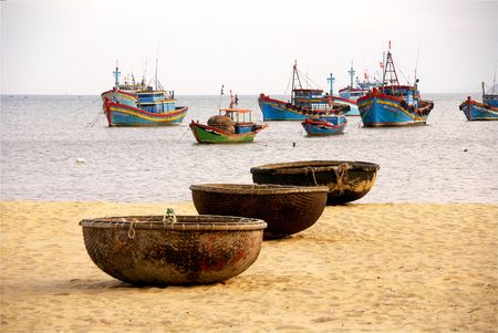 Fishing baskets and boats at Qui Nhon in Vietnam photo