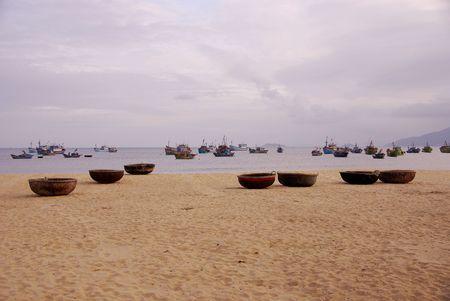 fishingboats: Fishing baskets and boats at Qui Nhon in Vietnam