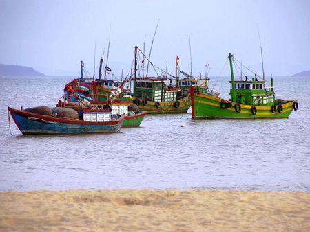 fishingboats: Colorful fishing boats at Qui Nhon in Vietnam Stock Photo