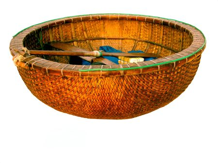 A bamboo woven fishing basket at the beach of Vietnam photo