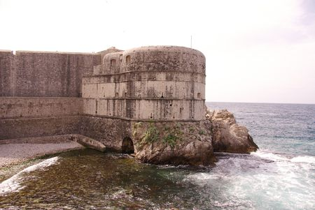 The defense towers and wall of Dubrovnik in Croatia photo