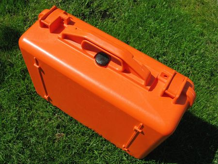 An orange suitcase in the grass Stock Photo - 5180607