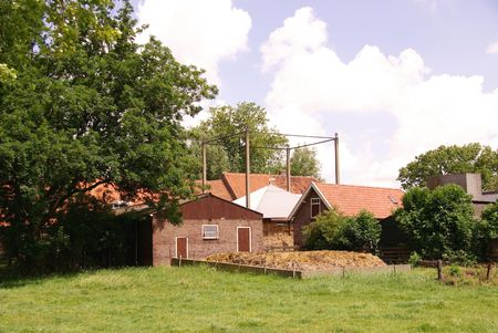 A farmhouse with barns and a haystack Stock Photo - 5247463