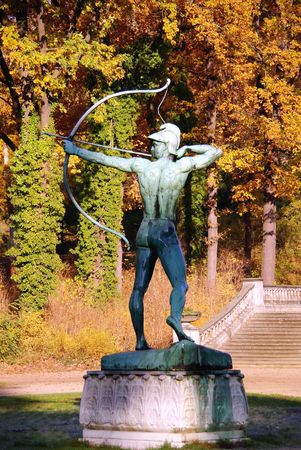 A statue of a hunter with bow and arrow photo