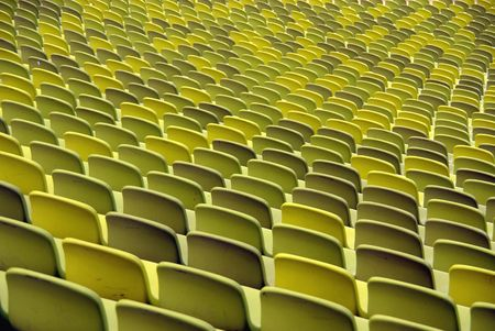 Green chairs in a stadium Stock Photo