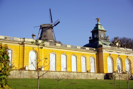 New chambers and historical windmill in the sanssouci royal park in Potsdam in Germany photo
