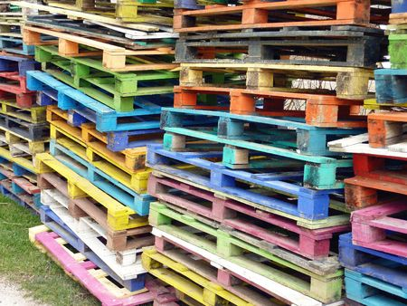 Piles of colorful wooden pallets photo