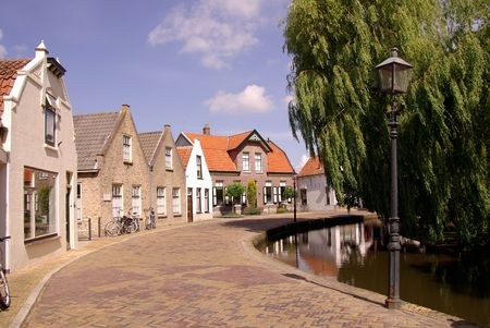 flakkee: Houses along the church canal in Dirksland in the Netherlands Stock Photo