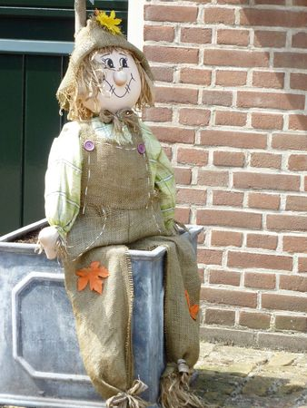 county side: A traditional straw doll is used as a scarecrow