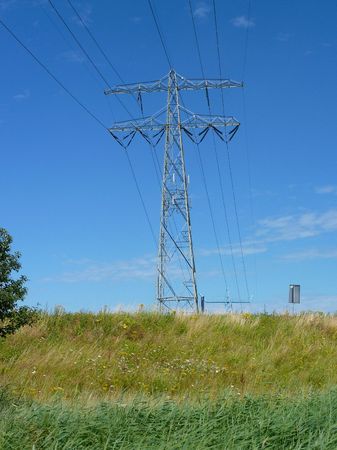 powerplants: The silhouette of an electricity mast Stock Photo